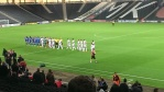 The Dons and AFC players shake hands before Tuesday's match
