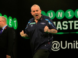 """Phil """"The Power"""" Taylor in The Unibet Masters in 2014.  Credit: Lawrence Lustig/PDC"""
