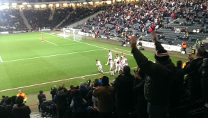 The Dons players celebrate Alli making it five